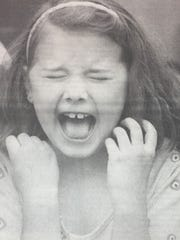 "Katie French reacted to the ""Kiss the Pig"" contest held at St. Ann's school in May 1993."