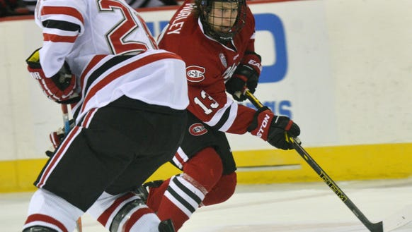 St. Cloud State's David Morley (13) carries the puck