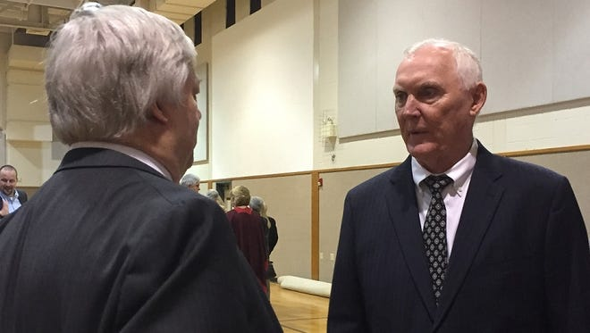 Former Centenary coach Riley Wallace (right) visits with former Centenary athletic director Taylor Moore following the Orvis Sigler memorial service Saturday.