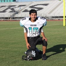 Gilbert Highland special needs student and equipment manager Omar Tafoya scored a touchdown in the team's scrimmage Wednesday night against Laveen Cesar Chavez.