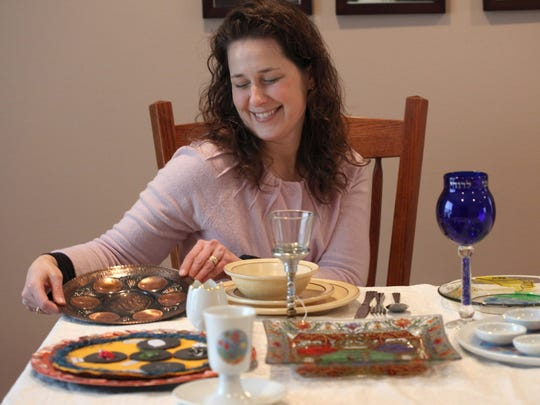 Rebecca Starr, 39, smiles as she holds a very special copper seder plate that belonged to her mother.