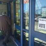 People enter Irondequoit polling place to vote on New York Primary Day, April 19, 2016.