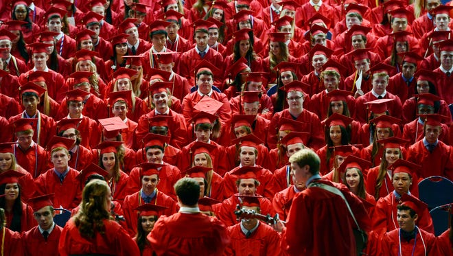 """Ravenwood High School graduates Anna Wellander, Connor Jeffries and Nickolas Mucci perform """"Take the World"""" during the commencement ceremony at the Belmont University Curb Event Center on Saturday, May 21, 2016, in Nashville, Tenn."""