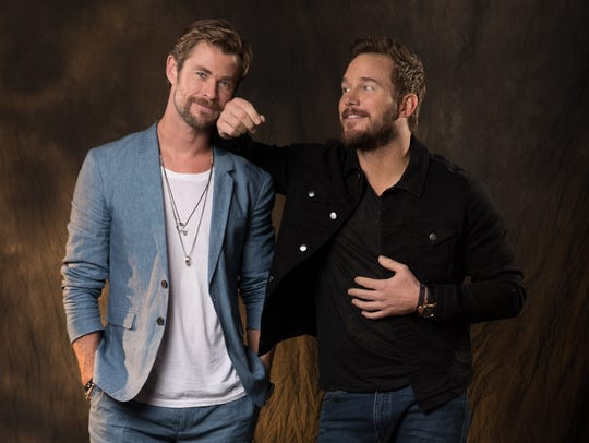 Chris Hemsworth, left, and Chris Pratt pose for a playful