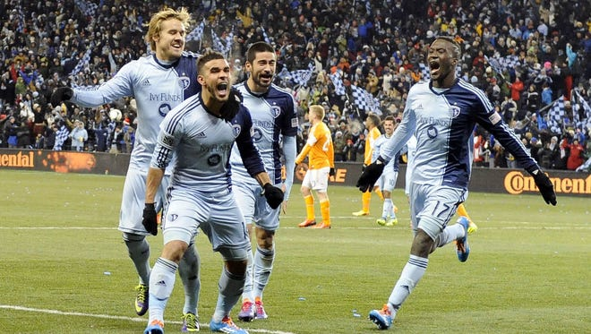 Sporting KC forward Dom Dwyer (14) is congratulated by teammates after scoring a goal against the Houston Dynamo in the second half of the MLS Eastern Conference Championship soccer game at Sporting Park.