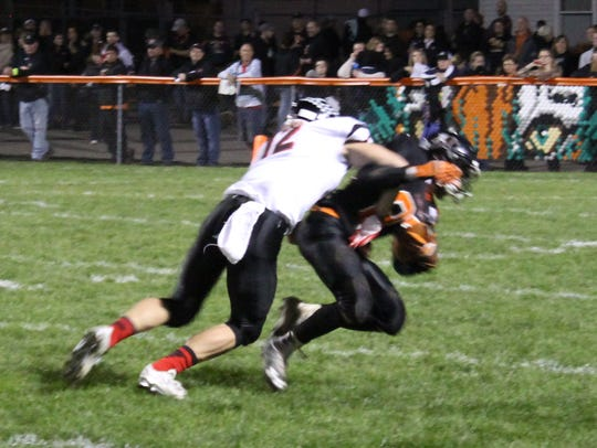 Marshfield wide receiver Andy Goettl takes a hard hit