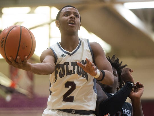 Fulton's Trey Davis (2) takes a shot while defended