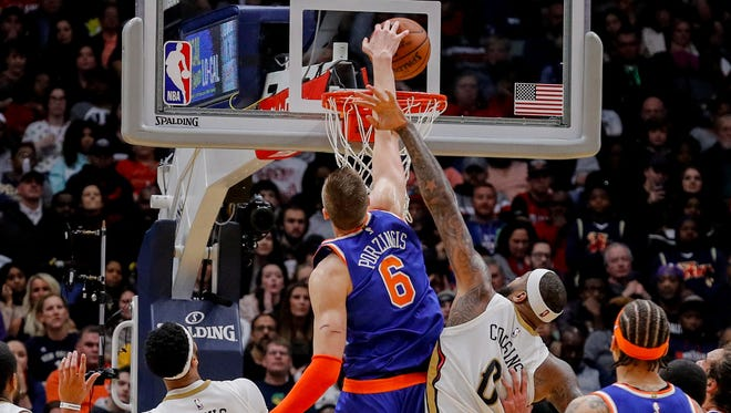 New York Knicks forward Kristaps Porzingis (6) dunks the ball during the forth period against New Orleans Pelicans center DeMarcus Cousins (0) at Smoothie King Center in New Orleans on Saturday, Dec. 30, 2017.