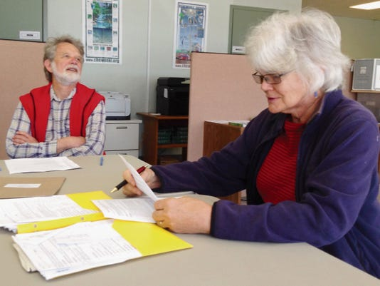 Terry Timme, recycling specialist for the Town of Silver City, and Jane Riger, committee member, discuss the city's Earth Day event during Thursday's Recycling Advisory Committee meeting in Silver City. Randal Seyler - Sun-News