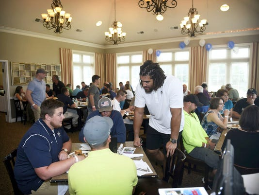 Lebanon native and Jacksonville Jaguars defensive lineman Jared Odrick chats with supporters of his third annual charity gold event at Iron Valley Golf Club on Saturday.