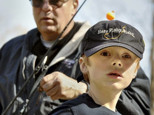 Abram Slenker wore his favorite fishing hat and caught a half dozen fish during the outing.