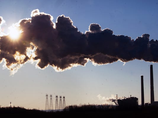 On a 10 degree morning PPL's Brunner Island coal fired plant emits white steam but because it is backlit by the sun and do dense it looks dark near York Haven January 23, 2013.  YORK DAILY RECORD/SUNDAY NEWS - PAUL KUEHNEL