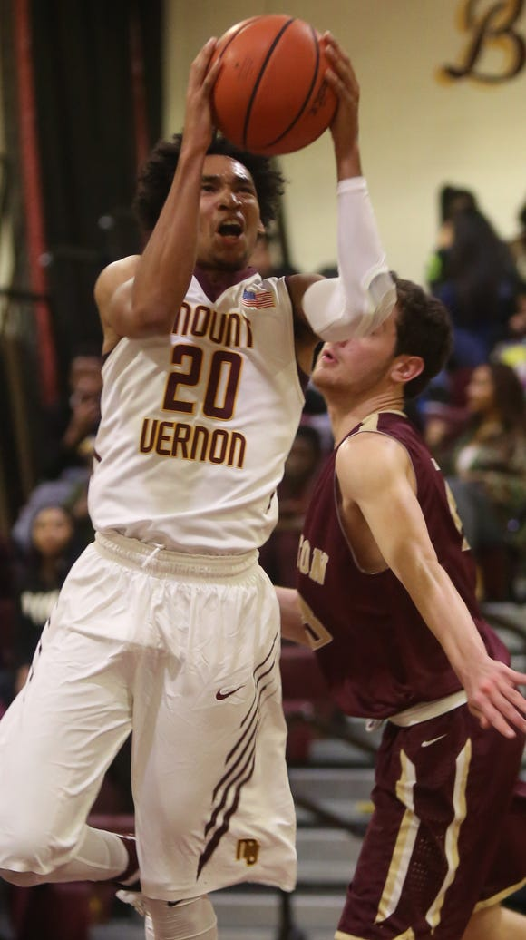 Mount Vernon's Jason Douglas-Stanley (20) goes up for