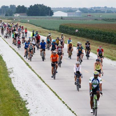 Riders head toward Hedrick during RAGBRAI on Friday,