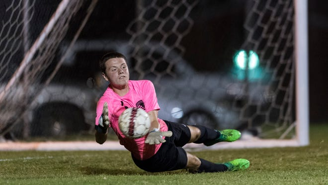 Henderson's goalkeeper Jacob Russ (1) blocks a shot at the goal by a Hopkinsville player at Colonel Field in Henderson, Ky., on Tuesday, Sept. 19, 2017. The Colonels and the Tigers tied, 5-5.
