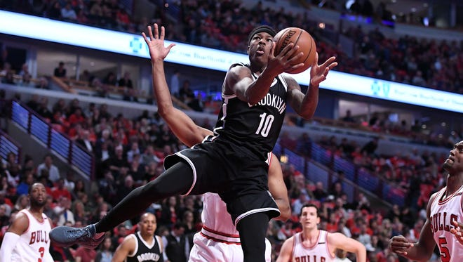Brooklyn Nets guard Archie Goodwin (10) shoots the ball against Chicago Bulls forward Cristiano Felicio (6) during the first half at the United Center.
