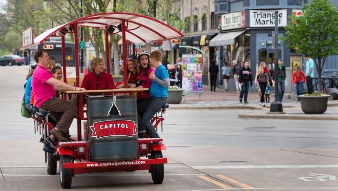 A 14-passenger commercial quadracycle on State Street in Madison.