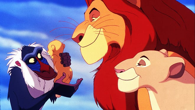 'The Lion King':  Rafiki (played by Robert Guillaume) prepares to present King Mufasa and Queen Saraki's son Simba as  the future ruler of the  Pride Lands.