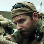 """The movie """"American Sniper"""" features actor Bradley Cooper as Chris Kyle, who was a Navy SEAL sharpshooter."""