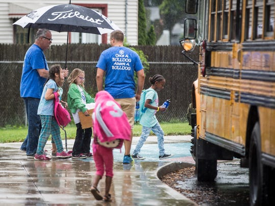 Students say goodbye to friends and teachers at Sutton Elementary on May 24 at the end of the Muncie Community School year. Sutton along with three other schools won't reopen in the fall.