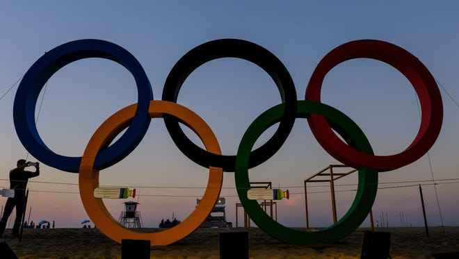 Olympic rings illuminated in the early morning at Copacabana beach.