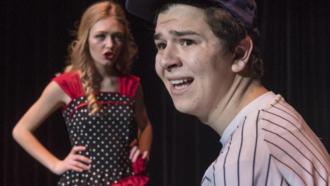 """Redwood students rehearse Tuesday, January 24, 2017 for their production of the musical """"Damn Yankees."""""""