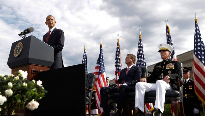 President Barack Obama speaks at a memorial observance ceremony at the Pentagon, Sunday, Sept. 11, 2016, to commemorate the 15th anniversary of the Sept. 11 attacks. With the president are Defense Secretary Ash Carter and Chairman of the Joint Chiefs of Staff Gen. Joseph Dunford, right.