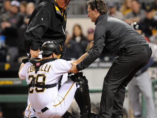 Pittsburgh Pirates' catcher Francisco Cervelli is helped up after an injury against the Atlanta Braves in a baseball game Monday, May 16, 2016 in Pittsburgh. (AP Photo/John Heller)