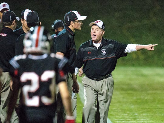 """West Branch head coach Butch Pedersen directs the bench against Bellevue during the first half of play in West Branch at the """"Little Rose Bowl"""" on Friday, September 26, 2014. (Justin Torner/Freelance for the Press-Citizen)"""