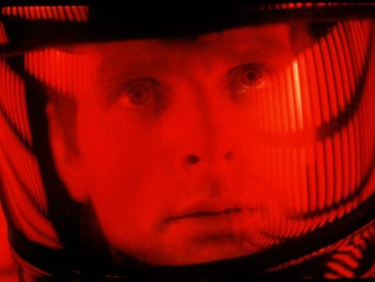 Actor Keir Dullea peers through his space helmet in