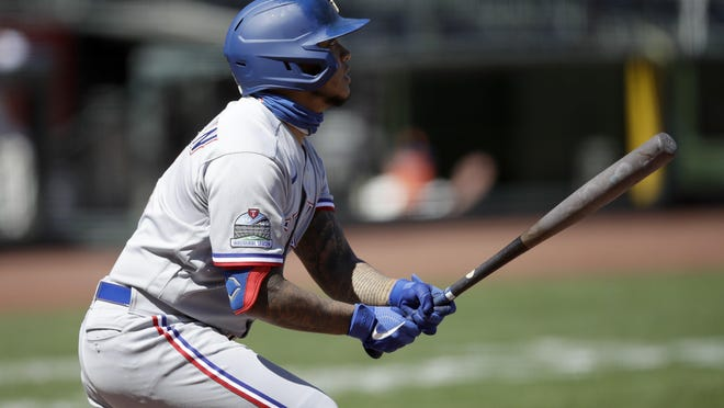 The Rangers' Willie Calhoun hits a sacrifice fly in the seventh inning to put his team ahead Sunday.