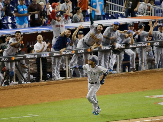 The American League team cheers the Seattle Mariners'