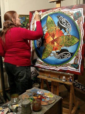 "Judy Pekelsma's is seen here working at her studio, Heart of the Raven, in Carrizozo. Her art exhibit at Eastern New Mexico University is called, ""Transformation."""