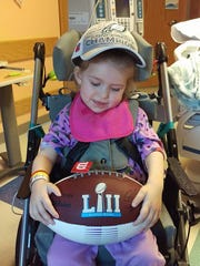 3-year-old Ruby Hoffman, of West Manchester Township, received a signed Super Bowl LII football and conference champions hat from Philadelphia Eagles Super Bowl champion Steven Means. She has been battling complications from a rare brain disease at Children's Hospital of Philadelphia for three weeks.