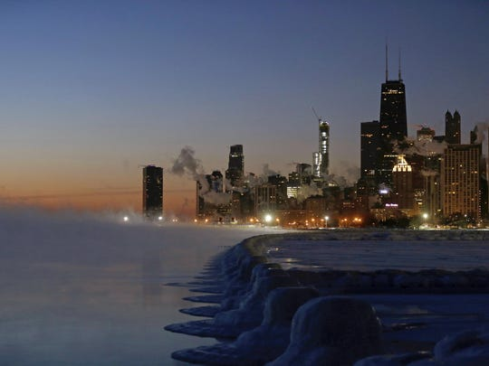 Ice forms along the shore of Lake Michigan before sunrise, Thursday, Jan. 31, 2019, in Chicago.