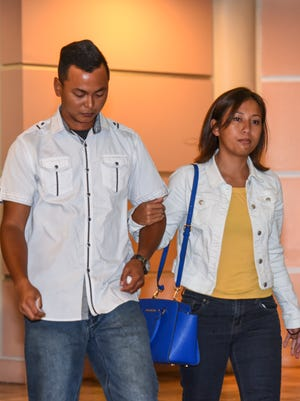 Couple, Shawn Cruz and Victoria (Siaotong) Cruz, exit the courtroom after their sentencing hearing at the Superior Court of Guam in Hagåtña on Friday, Sept. 22, 2017.