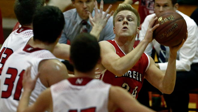 Ben Boots of Kimberly looks for an open man as Neenah defenders try to take the angle away during a Fox Valley Association boys' basketball game at Neenah on Dec. 12.