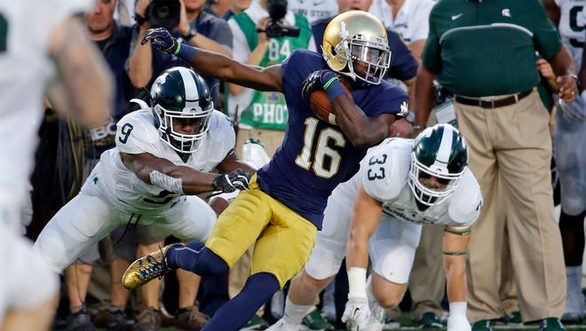 Notre Dame wide receiver Torii Hunter Jr. (16) cuts away from Michigan State safety Montae Nicholson (9) and linebacker Jon Reschke (33) after a catch during the first half of MSU's win Saturday in South Bend, Ind.