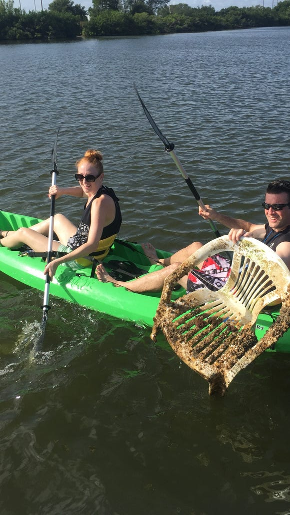 FLORIDA TODAY Advertising Director Stephanie McLoughlin and her husband  P.J. pulled a lot of junk from the Indian River Lagoon Saturday.