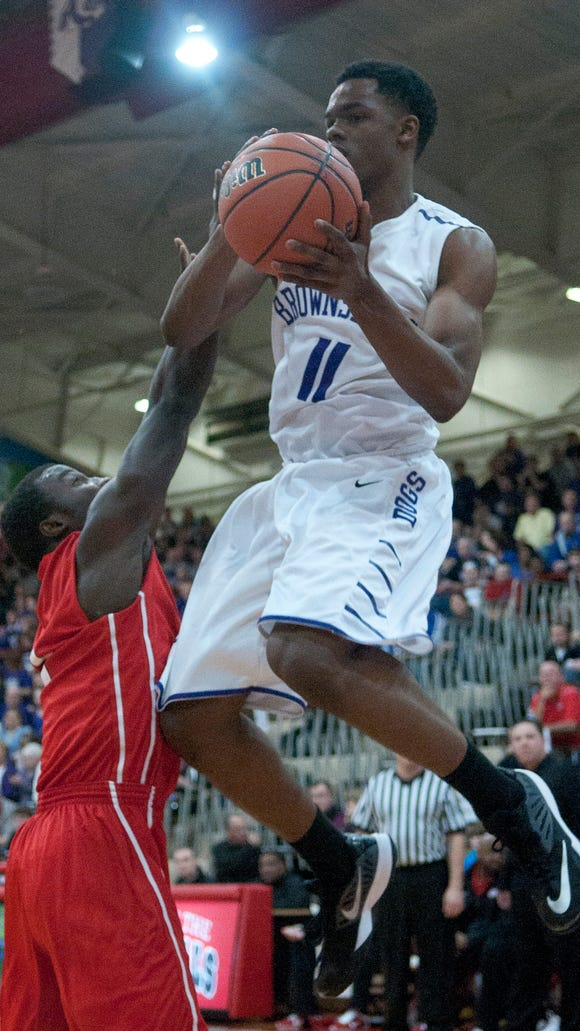 Brownsburg senior guard K.J. Walton remains uncommitted for 2015.