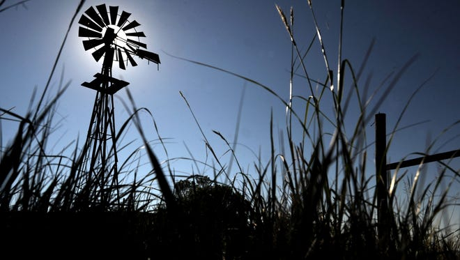A windmill stands in a area at Soapstone Prairie Natural Area Thursday July 26, 2012.