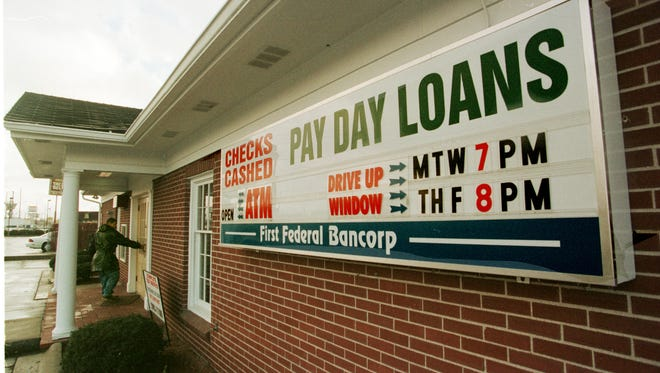 """Payday lenders in Indiana could charge criminal """"loan sharking"""" rates under a measure being considered Feb. 25, 2016, in an Indiana Senate committee hearing."""