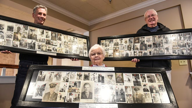 Randy Swope, left, Resie Lauer (center) and Terry Knapp (right) pose Tuesday, March 29, 2016, in Lauer's home at Kindred Place, Annville, with the frames containing photos of World War II veterans collected by the late Fred 'Toot' Lauer of Fredericksburg. Lauer, who was a barber, would ask servicemen to send him photos, which he displayed in his barbershop. Swope redid the photos and frames, and Knapp, a Bethel Township supervisor, is going to make sure the photos are displayed in the township building for all to see.