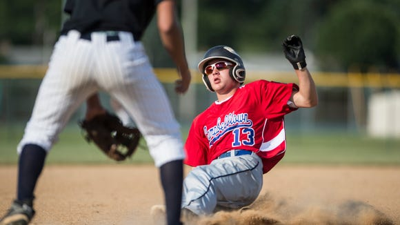 Campbelltown's Dylan Spagnolo slides into third base for his lead off triple as 5th Ward defeated Campbelltown 3-2 on Monday, June 20, 2016.