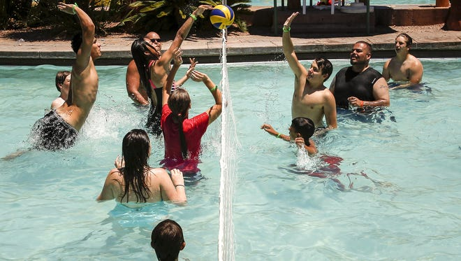 People play pick-up volleyball at Oasis Water Park on June 19, 2016