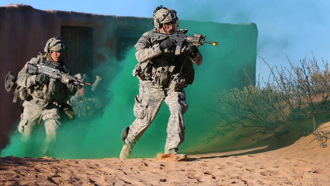 Soldiers from Fort Stewart, Ga., train at Fort Bliss earlier this year. Open government activists say the military funding bill will needlessly expand military secrecy.