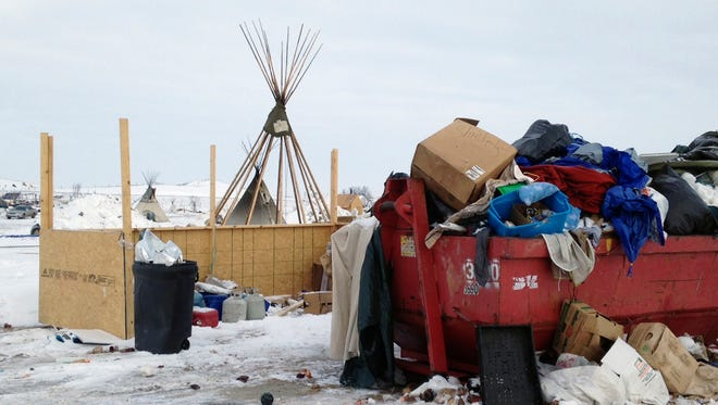 Trash is seen piled in a dumpster at an encampment set up near Cannon Ball, N.D., Wednesday, Feb. 8, 2017, for opponents against the construction of the Dakota Access pipeline.