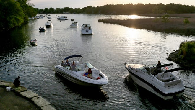 """The new law says all boats with an """"enclosed accommodation area"""" — sleeping areas, galleys with sinks, toilet compartments — must have a marine-certified carbon monoxide detector and post three warning stickers about carbon monoxide poisoning."""