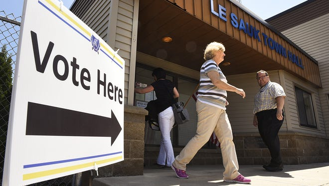 Residents go to the polls at the Le Sauk Town Hall in May 2016.
