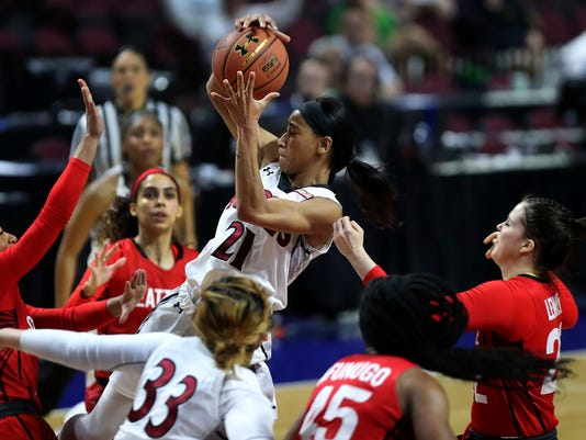 New Mexico State guard Tamera William (21) grabs a rebound against Seattle during the second half of NCAA college basketball game in the final of the Western Athletic Conference tournament on Saturday, March 11, 2017, in Las Vegas. (AP Photo/L.E. Baskow)